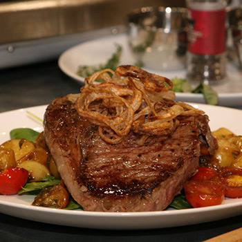 Image of Grilled Greg Norman Australian Wagyu Rib-Eye with Tomato Pan Sauce & Crispy Shallots